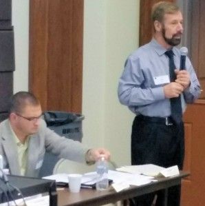 Among panelists were Austin Area School Superintendent Jerry Sasala (standing), who detailed the impact of tax-exempt state land on his district, and Potter County Chief Assessor Jake Ostrom (left).